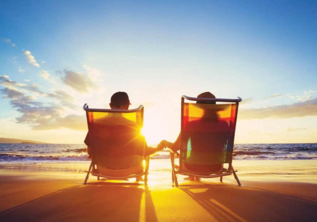 Couple sitting on the beach holding hands, ad for Flomentum