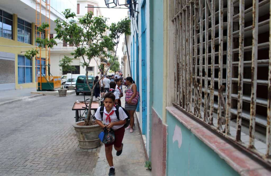 Kids running down the street in Old Havana