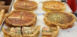 Quiches for sale in market.