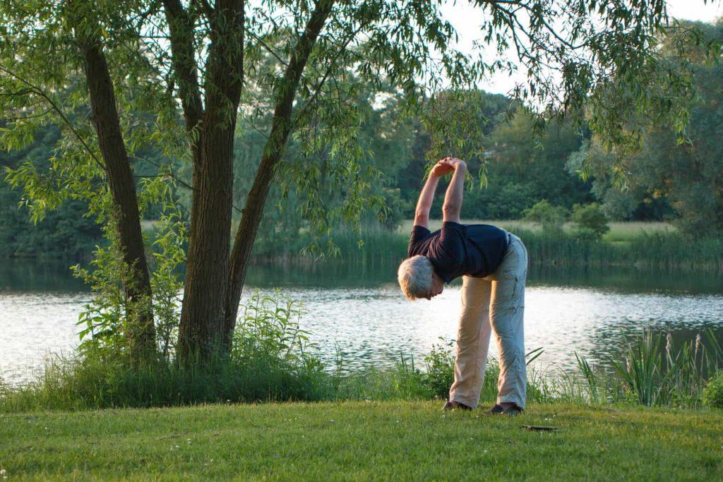 Man stretching on golf green.